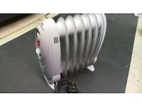 Small Portable Radiator Heater 2 heat settings perfect for camping caravan or small room