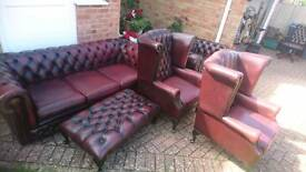 A selection of ox blood red leather Chesterfield furniture