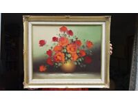 Old oil painting on canvas of flowers in gilt frame