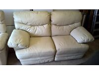 2 reclining cream leather 2 seater sofas.
