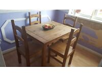 Wood dinning room table and chairs