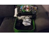 Still boxed comes with kinect, Disney infinity, headset, 2 controller's and abt 10 games.