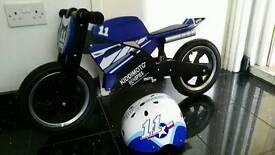 Child's Kiddimoto Ben Spies Wooden Balance Bike with helmet in very good condition