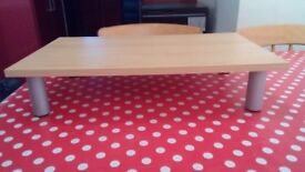T. V stand will fit on top of chest of drawers in bedroom. It can hold a full size t. V.