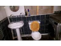 Toilet basin and taps
