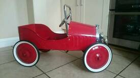 Vintage retro metal pedal car
