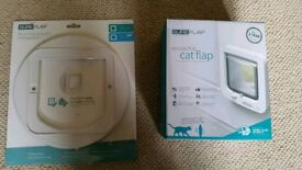 Brand new. Sureflap microchip cat flap with wall mounting adaptor