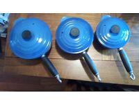 Le Creuset three piece blue pot set with lids.
