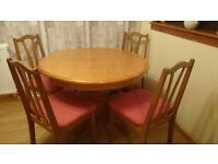 Table and 4 chairs a bit wear and tare hence the price but good sold table