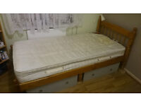 Single wooden bed frame with orthopedic mattress