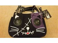 Cat handbag with speaker eyes