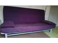 Purple three-seat sofa-bed, £30 (include coffee table or side table)