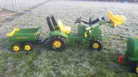 Two John deere tractors and trailers