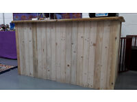 A beautful hand crafted solid wooden desk suitable for a shop point of sale desk or reception desk.