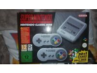 Super nintendo classic mini in excellent condition with 2 controls and all wires boxed