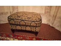 Low stool, fully upholstered, on 4, turned mahogany legs with brass castors. In good condition