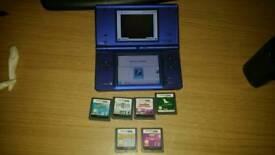 Nintendo dsi in metallic blue with games