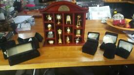 12 minature clocks in display case