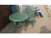 Plastic table and 2 matching chairs.