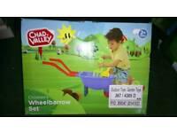 Toy wheel barrow