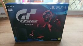BRAND NEW PLAYSTATION 4 with gran turismo. Never opened.