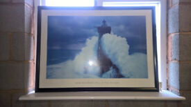 Dramatic framed photo of lighthouse in a storm