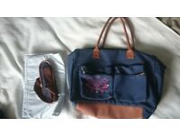 Brand new baby changing bag. Includes a long strap and the mat