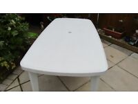 White garden table, 6 seater, good condition, removable legs for storage
