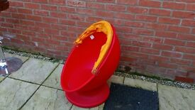 Kids egg chair from Ikea. Red/orange rotates 360 degrees