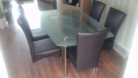 Smoked glass dining table and six chairs