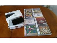 Nintendo DS with 8 games original box & carry case