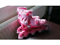 Inline roller blades. Hello Kitty. Size 13-3. Risport carry bag. Very good condition.