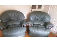 Two Green leather rocker /recliner chairs plus matching 3 seater sofa