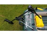 Inflatable fishing dinghy boat tender with electric outboard engine and battery