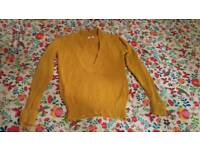 Beautiful mustard sweater. Good quality. Almost new.
