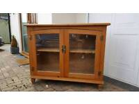 Solid pine glass fronted cabinet