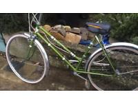 Old fashioned ladies puch bike