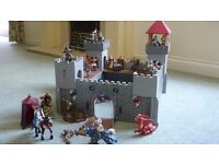 A child's wooden fort in very good condition with figures