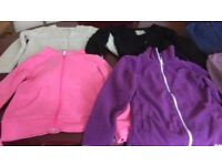 12 items of girls jumpers/cardigans/hoodied zip tops. Age 7-8. From M&S, Next, H&M etc