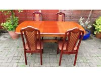 extendable solid wood oak dining table and chairs, very sturdy