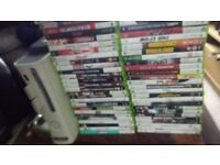 Xbox 360 with 120 GB hard drive three pads and 59 games and two spare hard drive and 4 battery pack