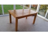 Oak veneer extendable table with four oak chairs