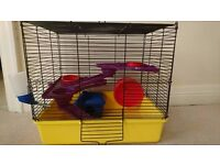 Hamster cage with homely accessories