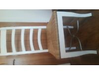 Four dining chairs and seat cushions
