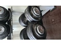 Heavy dumbells (42.5kg-60kg), rack and safety squat bar .
