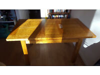 Extendable Dining Table. Very solid. Slight burn mark on surface.