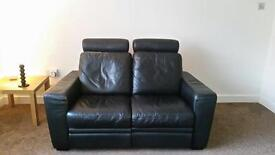 Black leather couch - £20