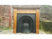 LARGE CAST IRON FIREPLACE AND SOLID PINE SURROUND