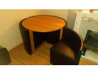 Nice good codition round table with slide in chairs