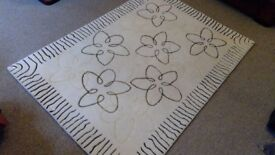 Cream patterned woollen RUG, good condition no marks, measures 55 inches x 80 inches £25
